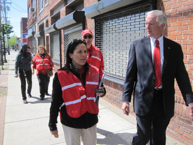 Bridgeport Mayor Bill Finch (at right) walks with Connecticut AARP State Director Nora Duncan observing conditions on East Main Street in Bridgeport, Conn. Walking behind them are AARP volunteer Mike Klein, Bridgeport City Councilwoman Lydia Martinez, and Bridgeport Director of Social Services Iris Molina.