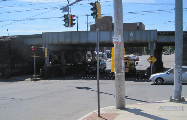 Pedestrian conditions near the viaduct which carries the New Haven Line over E. Main St are particularly poor.