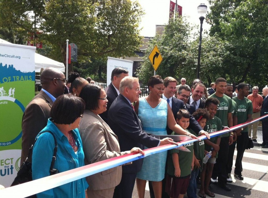Senator Menendez, Camden Mayor Redd, State Senator Donald Norcross and local leaders and community members officially open the Camden TIGER projects.